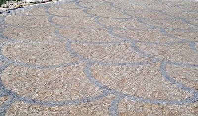 Le poseur de pav s en granit du portugal et de l 39 all e pav e for Poser des paves sur sable